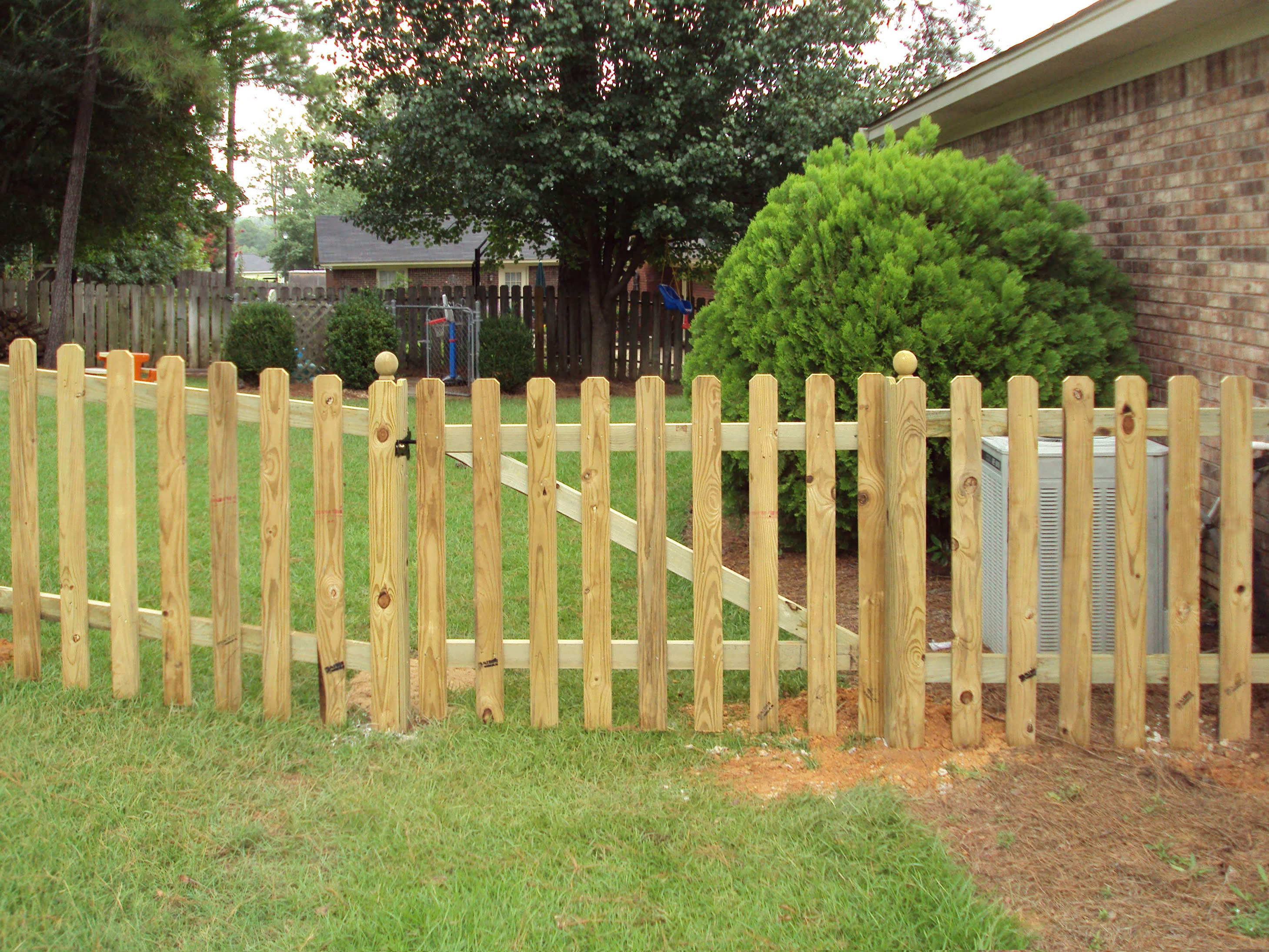 Wood fence anniston al the fence place short wood fence with spaces in backyard baanklon Gallery