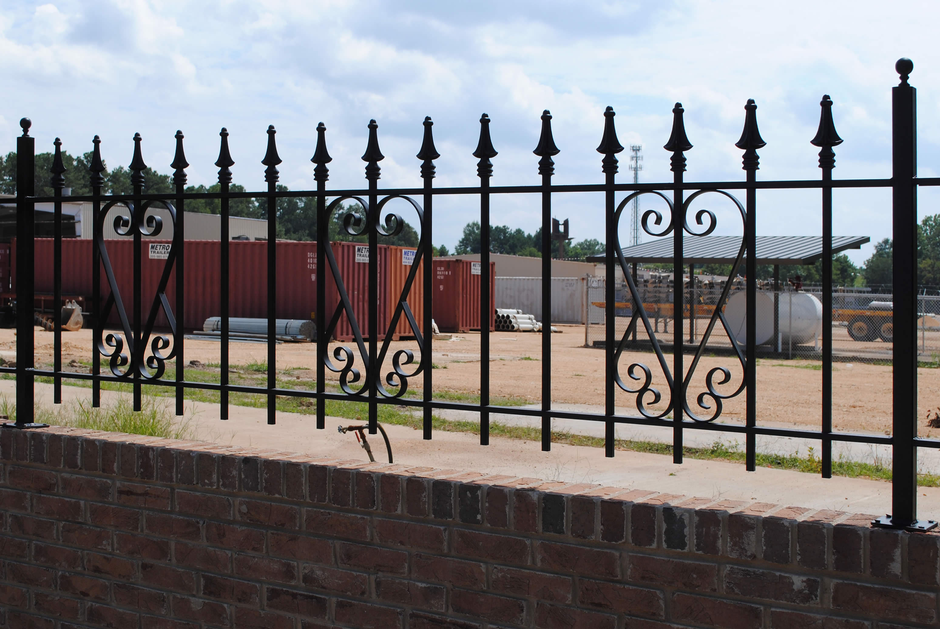ornamental fence with heart design atop brick wall - Decorative Fencing